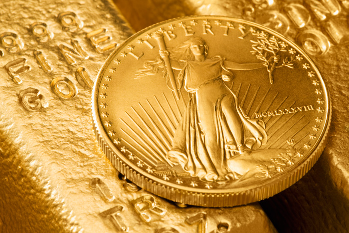 Goldbarren und Münze